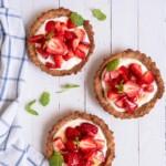 Three small Gluten-Free Strawberry Tarts filled with Greek yogurt seasoned with herbs and fresh strawberries.